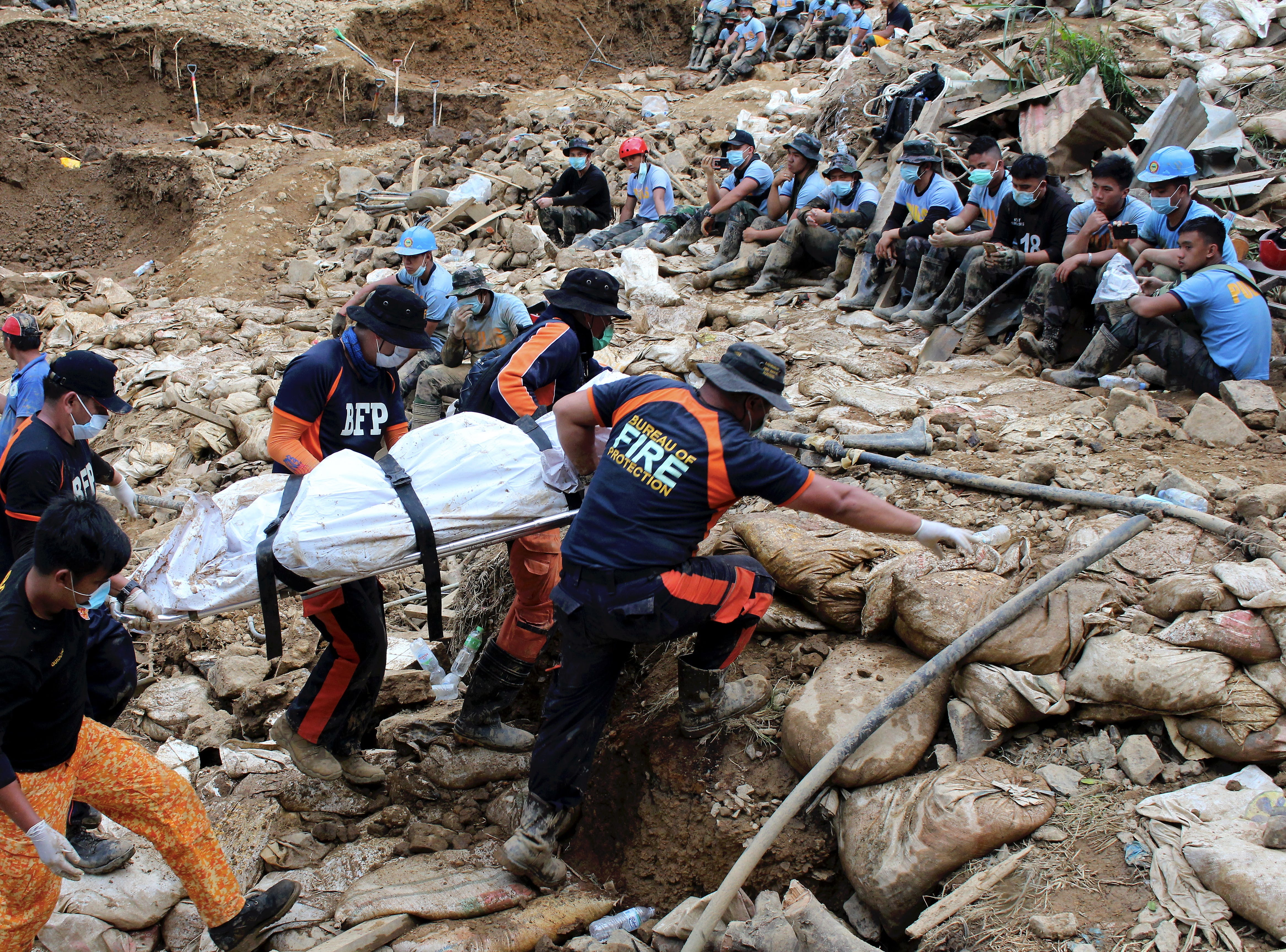 Rescuers carry a body during rescue and retrieval operation for landslide victims caused by Typhoon Mangkhut in Ucab village, Itogon town, Benguet Province, Philippines on Sept. 19, 2018 . The number of people killed in the Philippines by typhoon Mangkhut rose to 81 and dozens remain missing, according to provisional data gathered as emergency teams access areas struck by the storm.