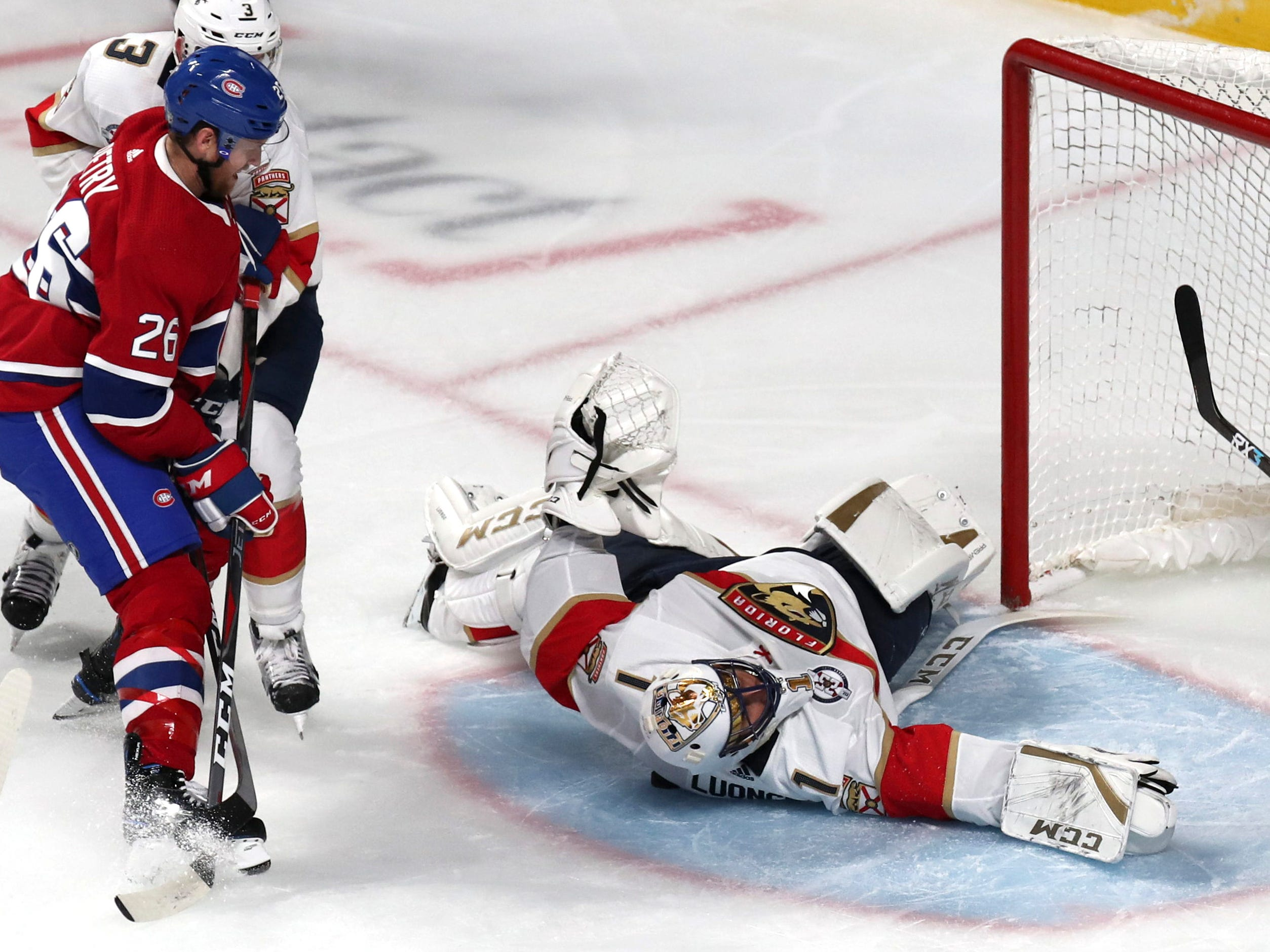 Sept. 19: Florida Panthers goaltender Roberto Luongo makes a save against Montreal Canadiens defenseman Jeff Petry while sprawled on the ice.