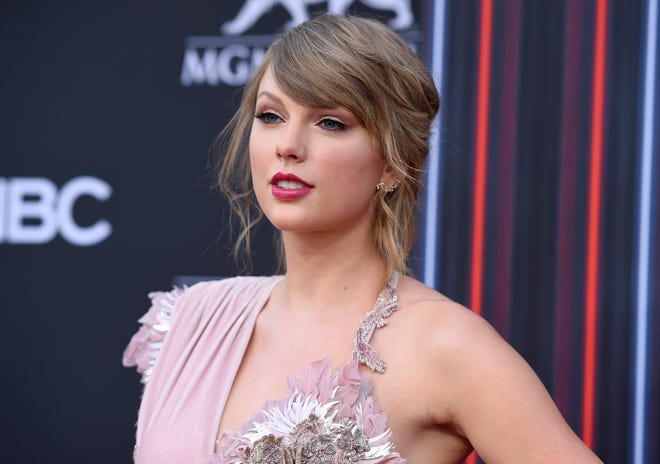 Eric Swarbrick, 26, of Austin, Texas, has been arrested on federal charges for sending threatening letters to Taylor Swift, pictured at the Billboard Music Awards in May.