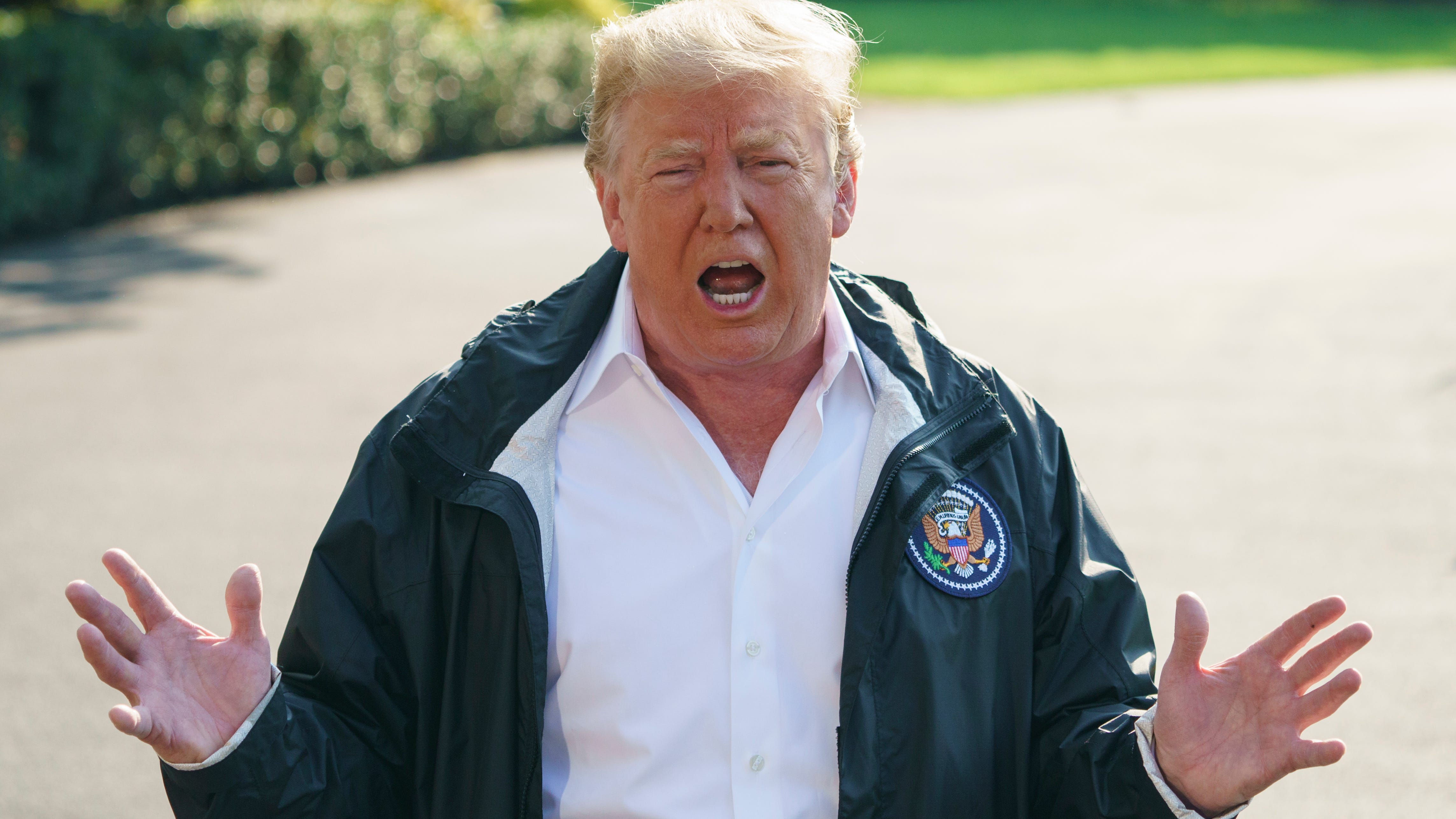 President Donald Trump talks to media before boarding Marine One on the South Lawn of the White House in Washington, Wednesday, Sept. 19, 2018, for the short trip to Andrews Air Force Base en route to Havelock, N.C. (AP Photo/Carolyn Kaster) ORG XMIT: DCCK101