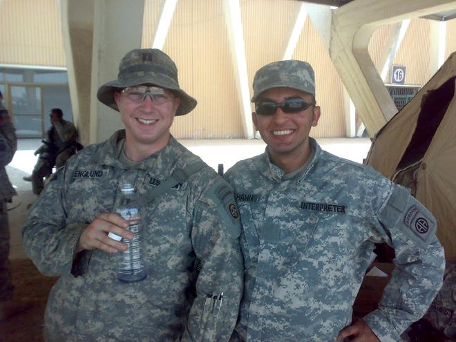 Iraqi interpreter Bassam Hashem, right, and U.S. Army Capt. Brian Englund in 2009. Hashem, like Sam in this editorial, is one of many Iraqis who have worked for the United States.