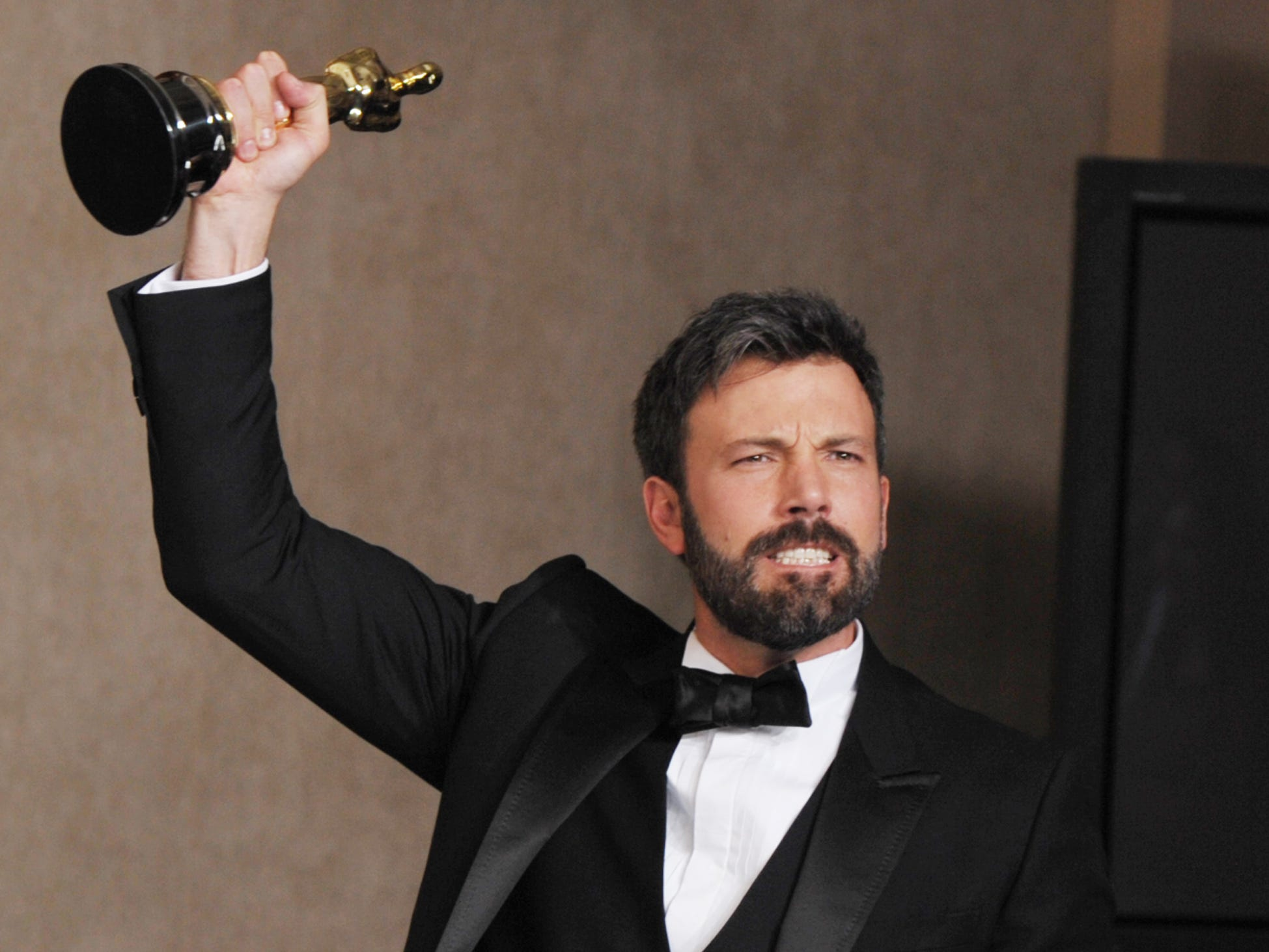 "FOR USE AS DESIRED, YEAR END PHOTOS - FILE - Ben Affleck poses with his award for best picture for ""Argo"" during at the Oscars at the Dolby Theatre on Sunday Feb. 24, 2013, in Los Angeles. (Photo by John Shearer/Invision/AP/File) ORG XMIT: NYYE159"