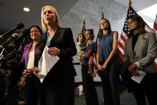 U.S. Sen. Kirsten Gillibrand, D-N.Y., holds a letter signed by Holton-Arms alumnae in support of Christine Blasey Ford, who has accused Supreme Court nominee Brett Kavanaugh of sexual assault at a high school party about 35 years ago, as left to right, Sen. Mazie Hirono, D-Hawaii, alumnae Kate Gold, Sarah Burgess and Alexis Goldstein look on Sept. 20, 2018, at Hart Senate Office Building on Capitol Hill in Washington, D.C.