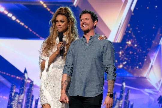 'America's Got Talent' host Tyra Banks, left, stands with fifth-place finisher Michael Ketterer, who performed a Garth Brooks song written especially for him on Wednesday's Season 13 finale.