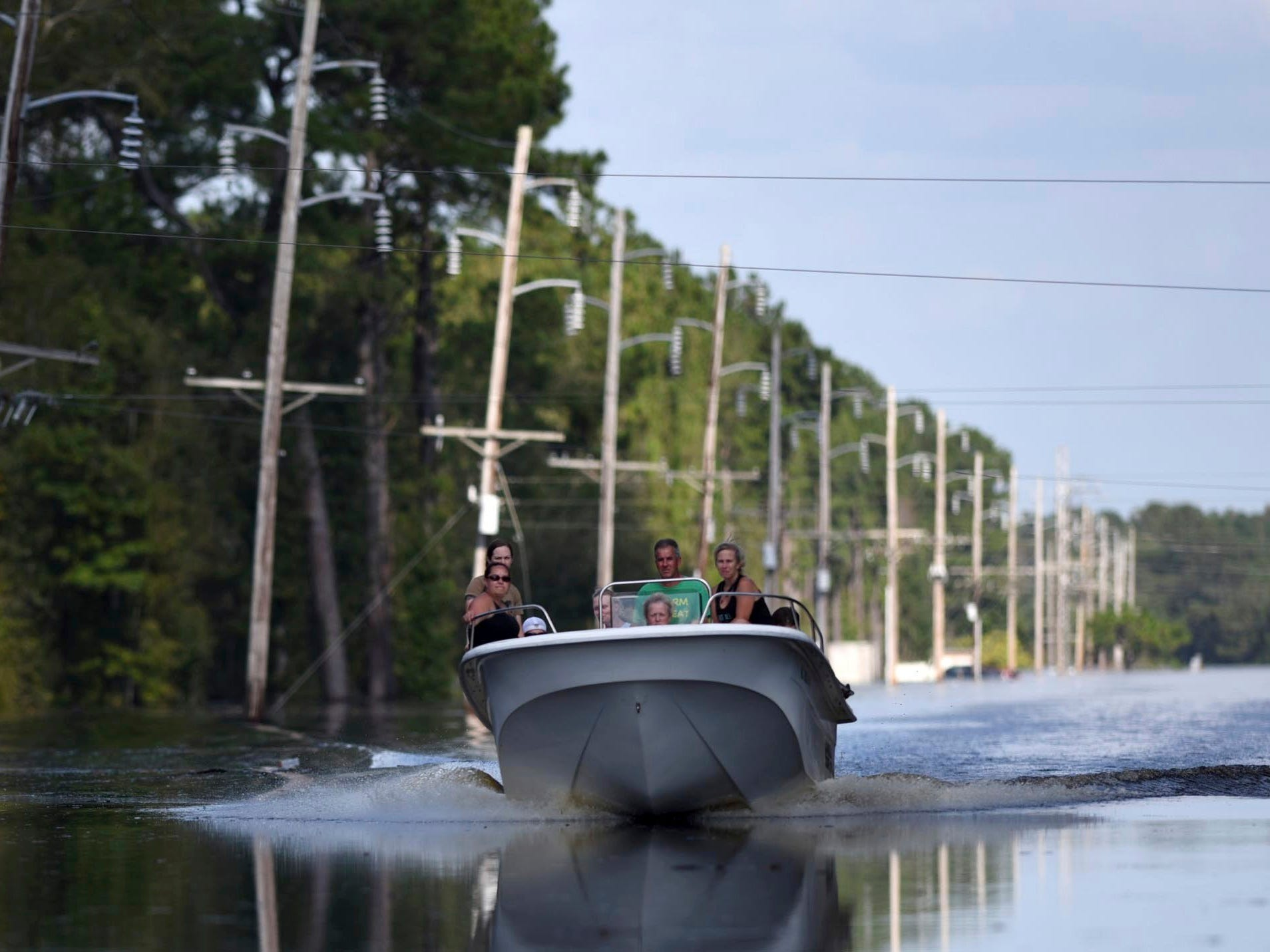 Area residents ride around neighborhoods flooded from the Northeast Cape Fear River in Burgaw, N.C. on Sept. 19, 2018.