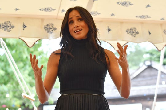 Duchess Meghan speaks to guests at the launch of a cookbook with recipes from a group of women affected by the Grenfell Tower fire at Kensington Palace on Sept. 20, 2018.