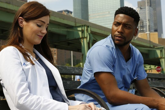 "Janet Montgomery as Dr. Lauren Bloom and Jocko Sims as Dr. Floyd Reynolds on ""New Amsterdam."""