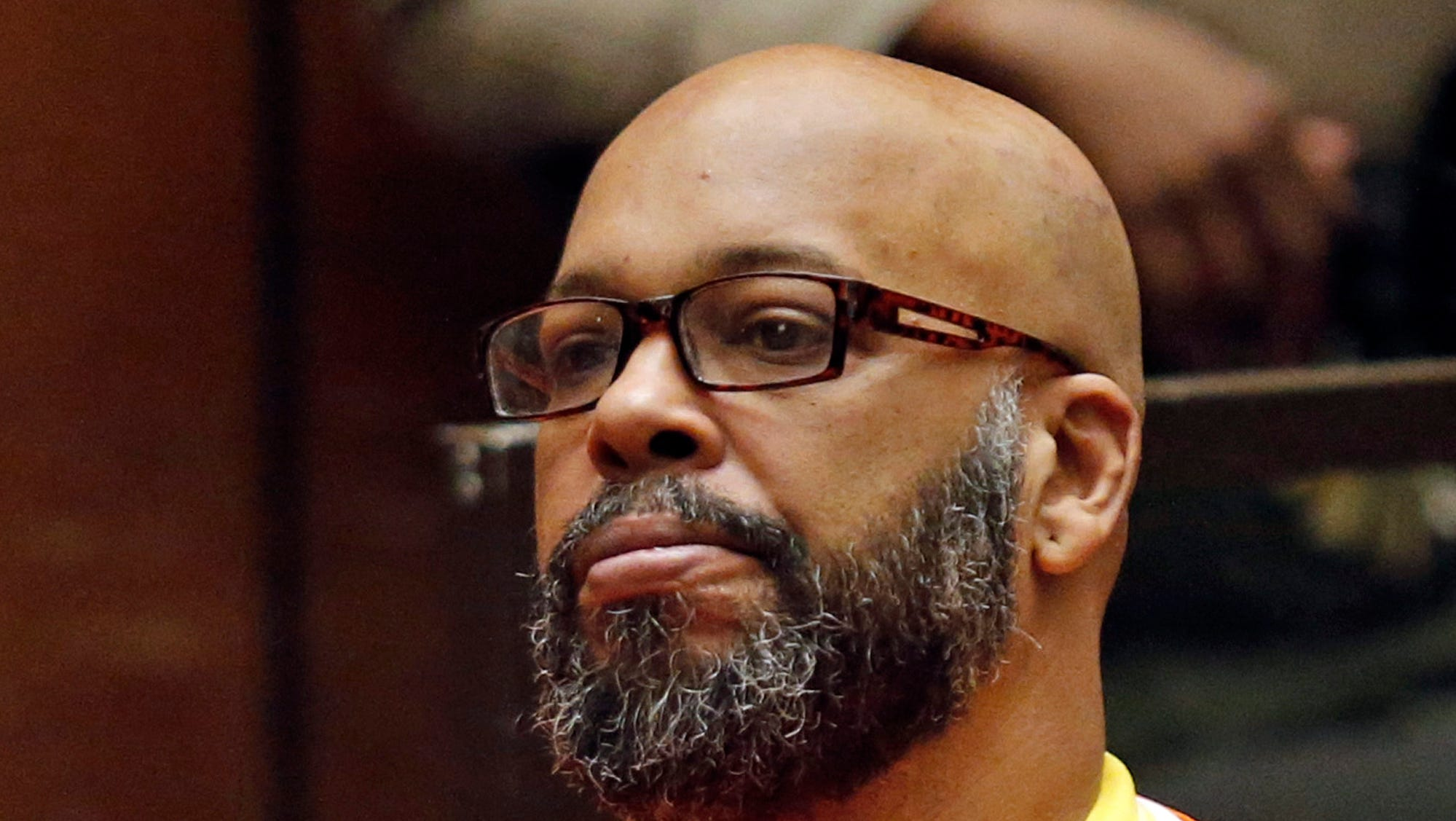 """Marion Hugh """"Suge"""" Knight sits for a hearing in his murder case in Superior Court in Los Angeles. Knight has pleaded no contest to voluntary manslaughter and after he ran over two men, killing one, nearly four years ago. The Death Row Records co-founder entered the plea Thursday in Los Angeles Superior Court and has agreed to serve 28 years in prison."""