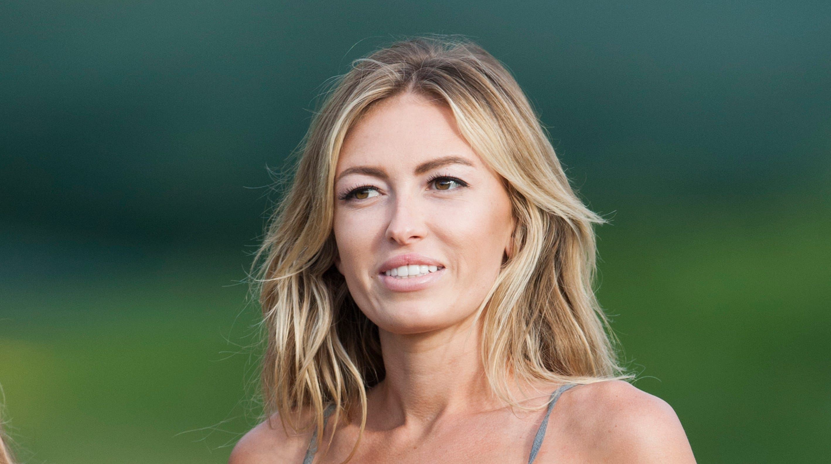 Paulina Gretzky is seen near the 18th fairway during the first round of the Tournament of Champions golf tournament, Friday, Jan. 3, 2014, in Kapalua, Hawaii.