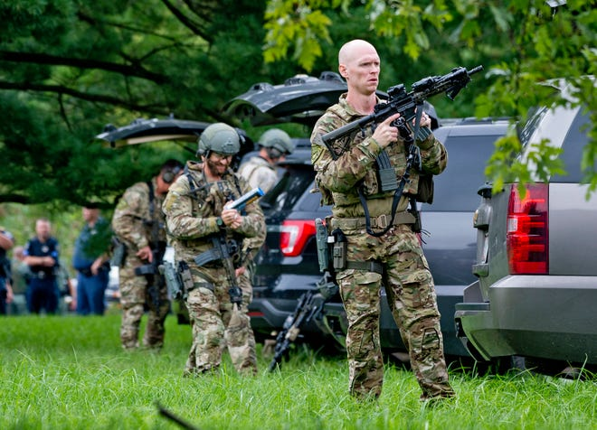 FBI tactical agents at the scene of a shooting at a Rite Aid Distribution Center in Aberdeen, Maryland, on Sept. 20, 2018.