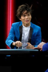 """Magician Shin Lim wowed """"American Ninja Warrior"""" co-hosts Akbar Gbaja-Biamila  and Matt Iseman and host Tyra Banks during the final show and walked away with the $1 million prize on """"America's Got Talent."""""""