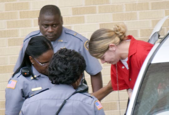 Hanna Nicole Barker (far right), the mother of a baby who died after being found in a fire, arrives at the Natchitoches Parish Courthouse on Sept. 21 for several hearings in her case. Barker faces a revocation hearing Oct. 10 after officials allege she violated terms of her probation stemming from 2016 drug charges.