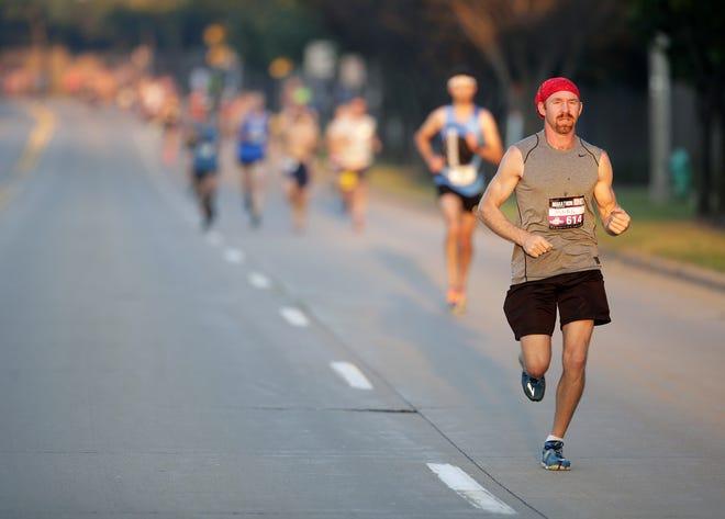 Mark Jasper of Menominee runs down Midway Road during last year's Community First Fox Cities Marathon.