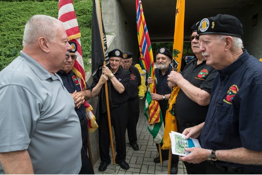 Ken Gurbisz of Eatontown lost his son Capt. James Gurbisz during the war in Iraq in 2005. He talks with members of the VVA Chapter 12 color guard. The POW/MIA Gold Star Mothers Recognition Ceremony takes place at the New Jersey Vietnam Veterans' Memorial. The ceremony honors women as well as others who lost family members during military conflict. Holmdel, NJFriday, September, 21, 2018