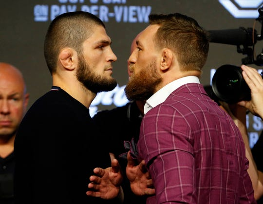 Khabib Nurmagomedov and Conor McGregor face off during a press conference for UFC 229 at Radio City Music Hall. Mandatory Credit: Noah K. Murray-USA TODAY Sports
