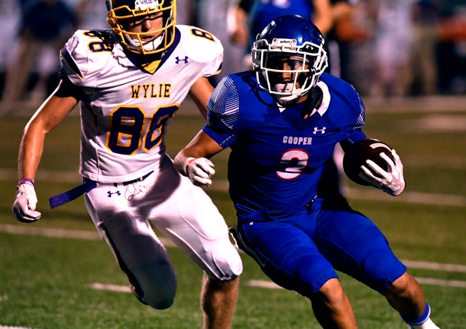 Wylie's Brodey Baker pursues Cooper running back Noah Garcia. Garcia, a sophomore, had a career night gaining 169 yards on 16 carries.