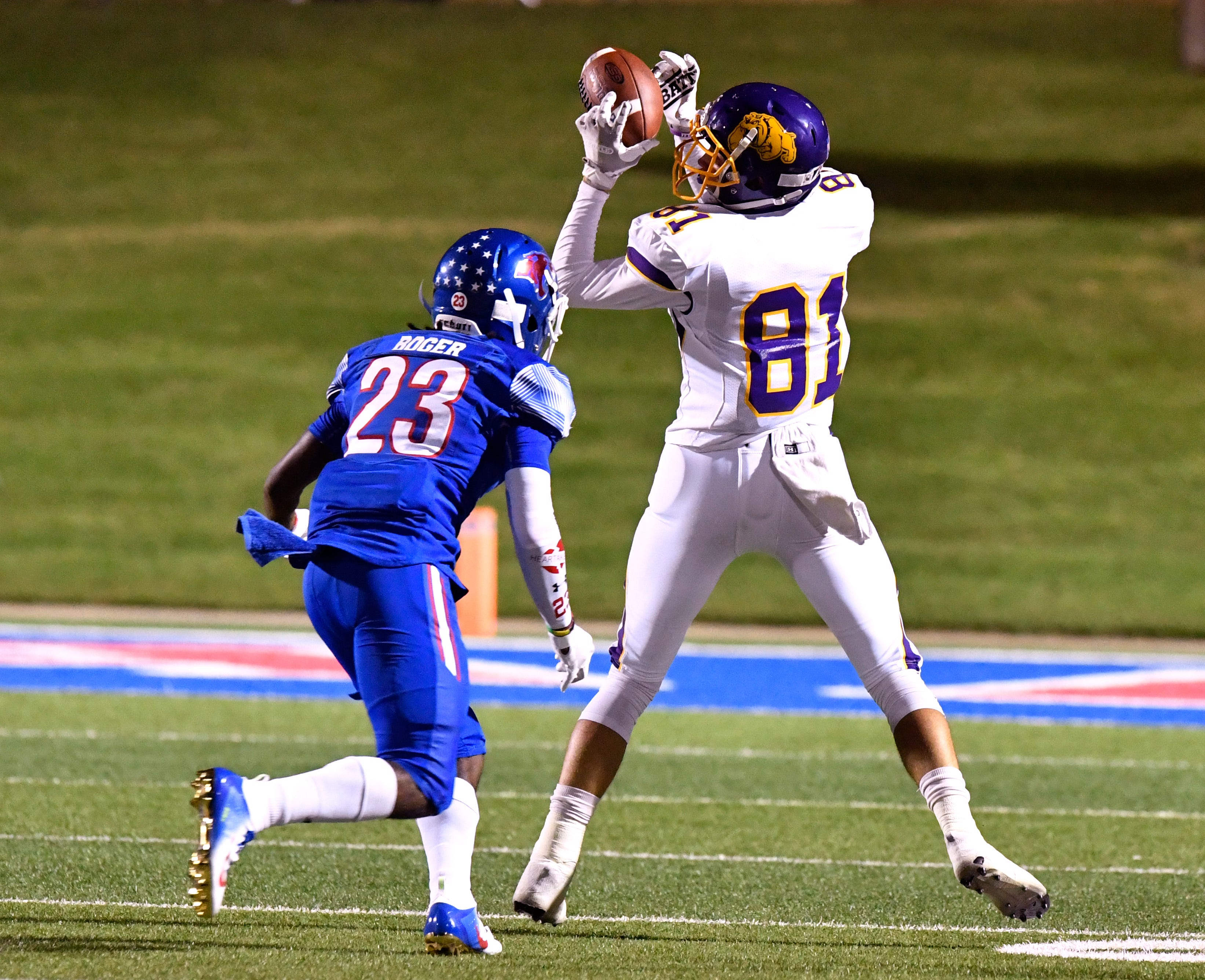 Wylie wide receiver Hayden Keidl completes a pass as Cooper defensive back Roderick Boger tries to cover him. Cooper and Wylie high schools faced each other for the first time Thursday Sept. 20, 2018 for the Southtown Showdown at Shotwell Stadium. Cooper won, 48-0.