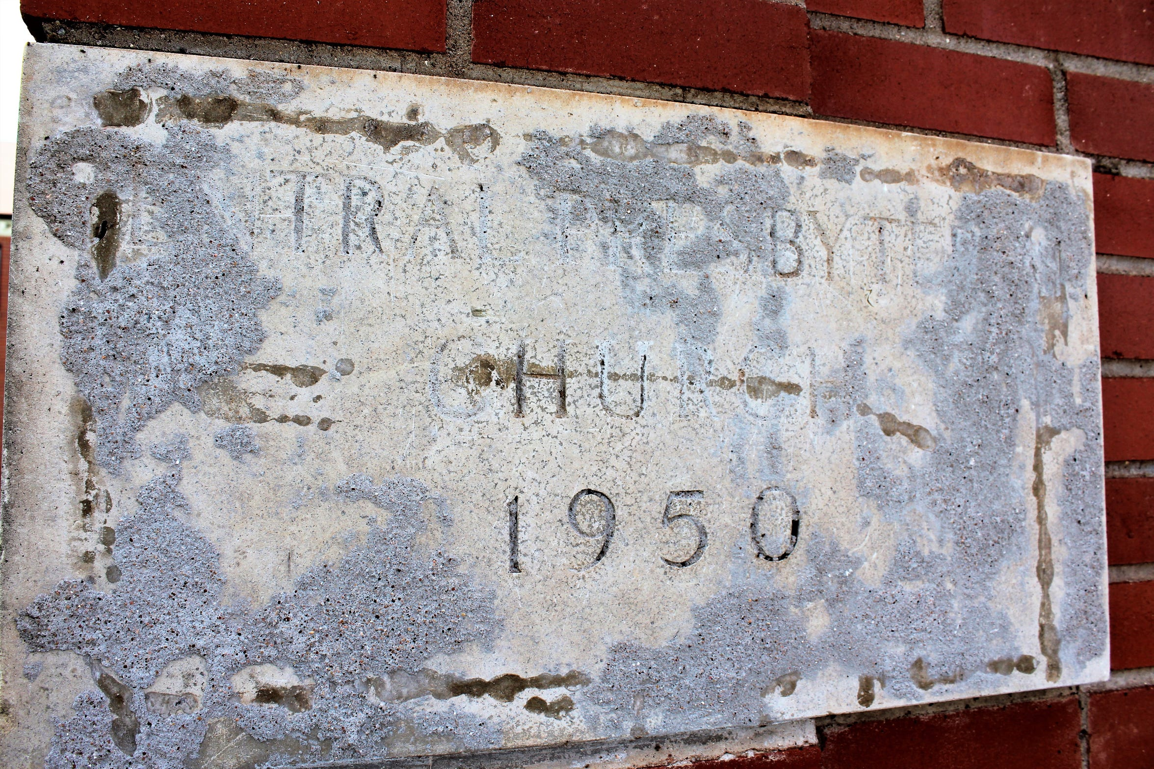 The faded cornerstone of what once was Central Presbyterian at the corner of North Fifth and Grape streets, which became home to a Church of Christ congregation.
