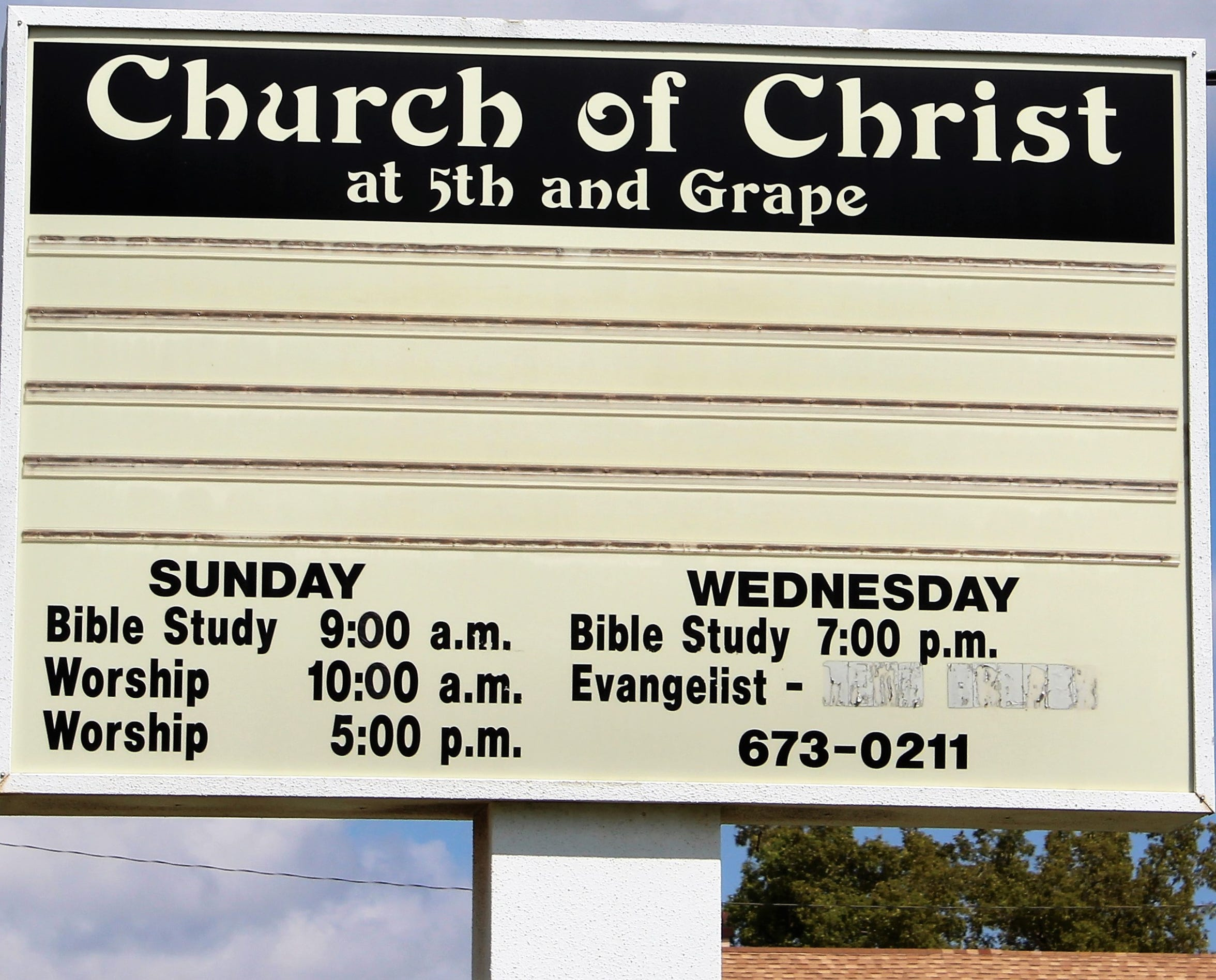 The sign at North Fifth Street and Grape Church of Christ is blank, listing no activities or inspirational message and no minister.