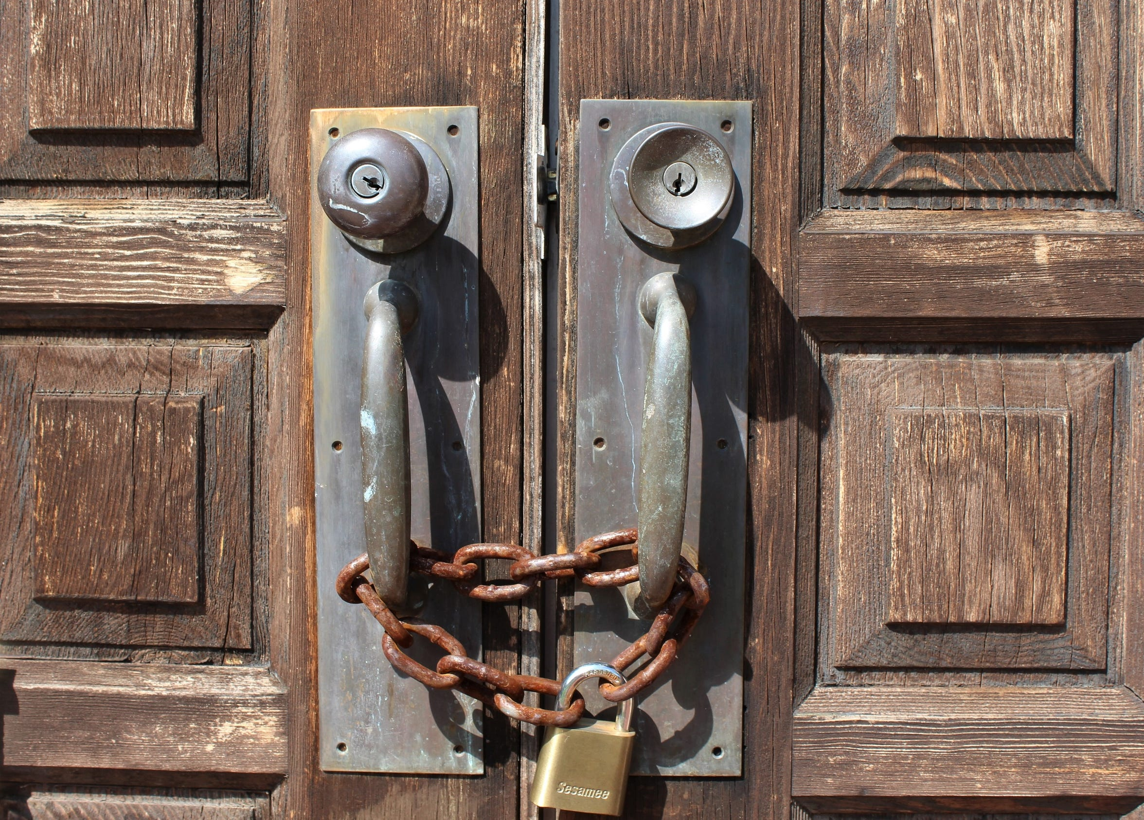 The doors to a former church in the 1400 block of Hickory Street are secured by a chain.