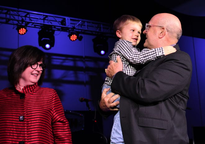 2018 Outstanding Citizen of the Year Tim Lancaster shared the spotlight Thursday evening with two grandchildren, including Hooper, 3, and, of course, his wife, Regina. Lancaster is the retiring president and CEO of Hendrick Health System.