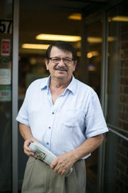 Pete Apostolopoulos stands in front of the Mediterranean Restaurant in downtown Asheville.