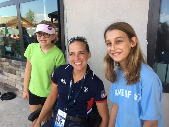 U.S. Paralympian Becca Hart, center, greets fans Sasha Bilsborrow, left and Cailin Dombeck, of Durham, on Thursday. Hart won the bronze in para-dressage at the World Equestrian Games, the first such medal for the U.S.