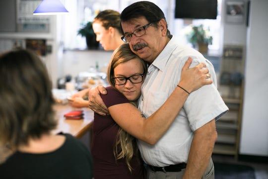 Pete Apostolopoulos hugs new owner Rachel Goodman.