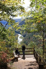 Tourists overlook the gorgeous view of the Pennsylvania Grand Canyon in Tioga, Lycoming and Clinton counties