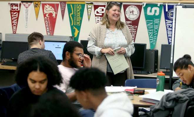 Bremerton High School AVID class teacher Lisa Gordon instructs seniors in class last month. AVID is a college preparatory course aimed at students who may be the first in their family to go to college.