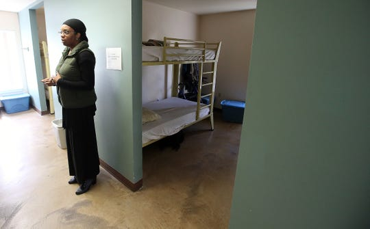 Benedict House program manager Faatima Lawrence stands outside a dorm room at the Benedict House in Bremerton. The Benedict House is a shelter for homeless men, and it works with CHI Franciscan and Peninsula Community Health Center to provide respite care to those recently discharged from the hospital but not well enough to return to the streets.