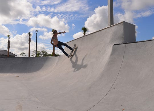 Moose Straney goes up the wall at the new West Melbourne skate park.