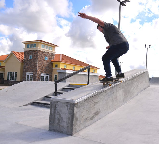 """Jerry """"Limey"""" Lineweaver does a 50/50 grind at West Melbourne's new skate park."""
