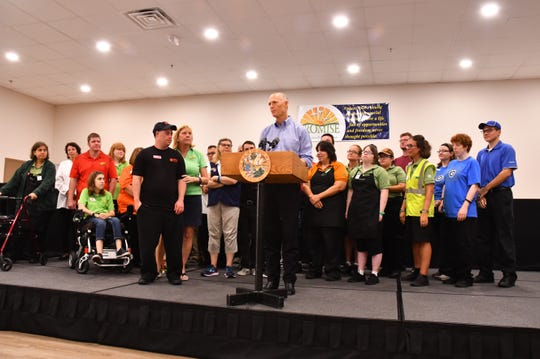 Gov. Rick Scott paid a visit to Promise in Brevard in West Melbourne Friday morning to announce job numbers and present Governor's Business Ambassador Awards to Betsy Farmer and her son Luke, co-founders of Promise in Brevard.