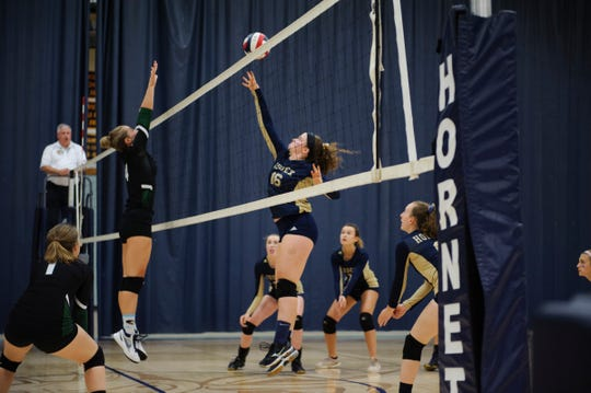 Essex's Maddie Folsom (16) plays the ball during the girls volleyball game between the Rice Green Knights and the Essex Hornets at Essex High School on Thursday afternoon September 20, 2018 in Essex.