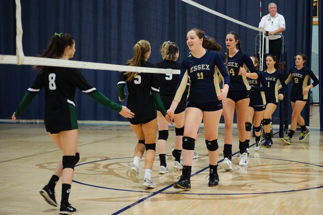 Essex and Rice shake hands before the girls volleyball game between the Rice Green Knights and the Essex Hornets at Essex High School on Thursday afternoon September 20, 2018 in Essex.