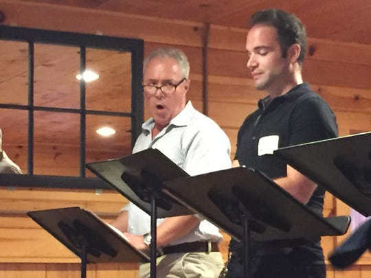 """Cast members Ben Ash and Justin D. Quackenbush take part in a reading of """"The Curious Incident of the Dog in the Night-Time"""" at a Vermont Stage event at Isham Family Farm in Williston on Sept. 17, 2018."""
