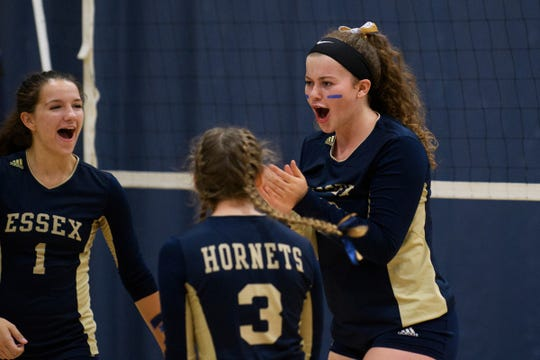 Maddie Folsom celebrates a point with her teammates during a 2018 match at Essex High School. Folsom was named the Vermont Gatorade girls volleyball player of the year on Tuesday.