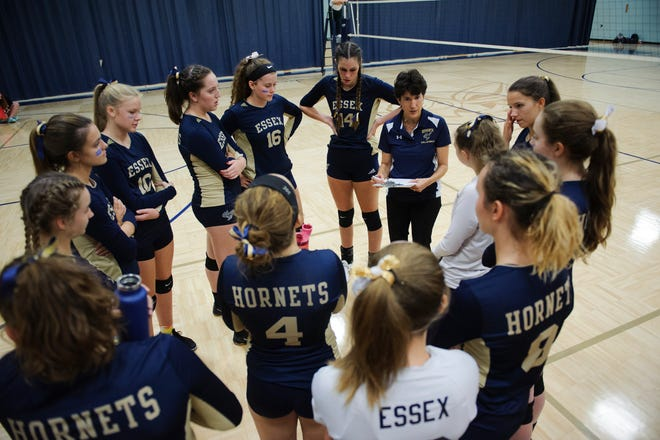 Essex huddles together between games during the girls volleyball game between the Rice Green Knights and the Essex Hornets at Essex High School on Thursday afternoon September 20, 2018 in Essex.