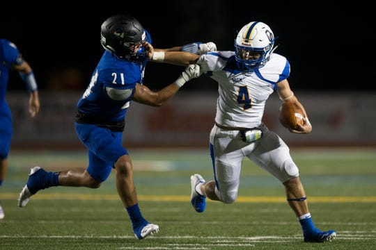 Odem's Rudy Piana stiff arms Santa Gertrudis Academy's Matt Gonzalez during their game on Thursday, Sep. 20, 2018, at Javelina Stadium in Kingsville.