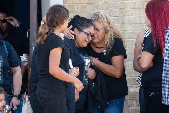 A woman is embraced as she leaves Holy Redeemer Catholic Church in Laredo, Texas, for the funeral service for Nikki Enriquez on Friday, Sept. 21, 2018. Border Patrol supervisor Juan David Ortiz was arrested Sept. 15, 2018, in connection with the killing of Enriquez, a transgender woman, along with three other women.