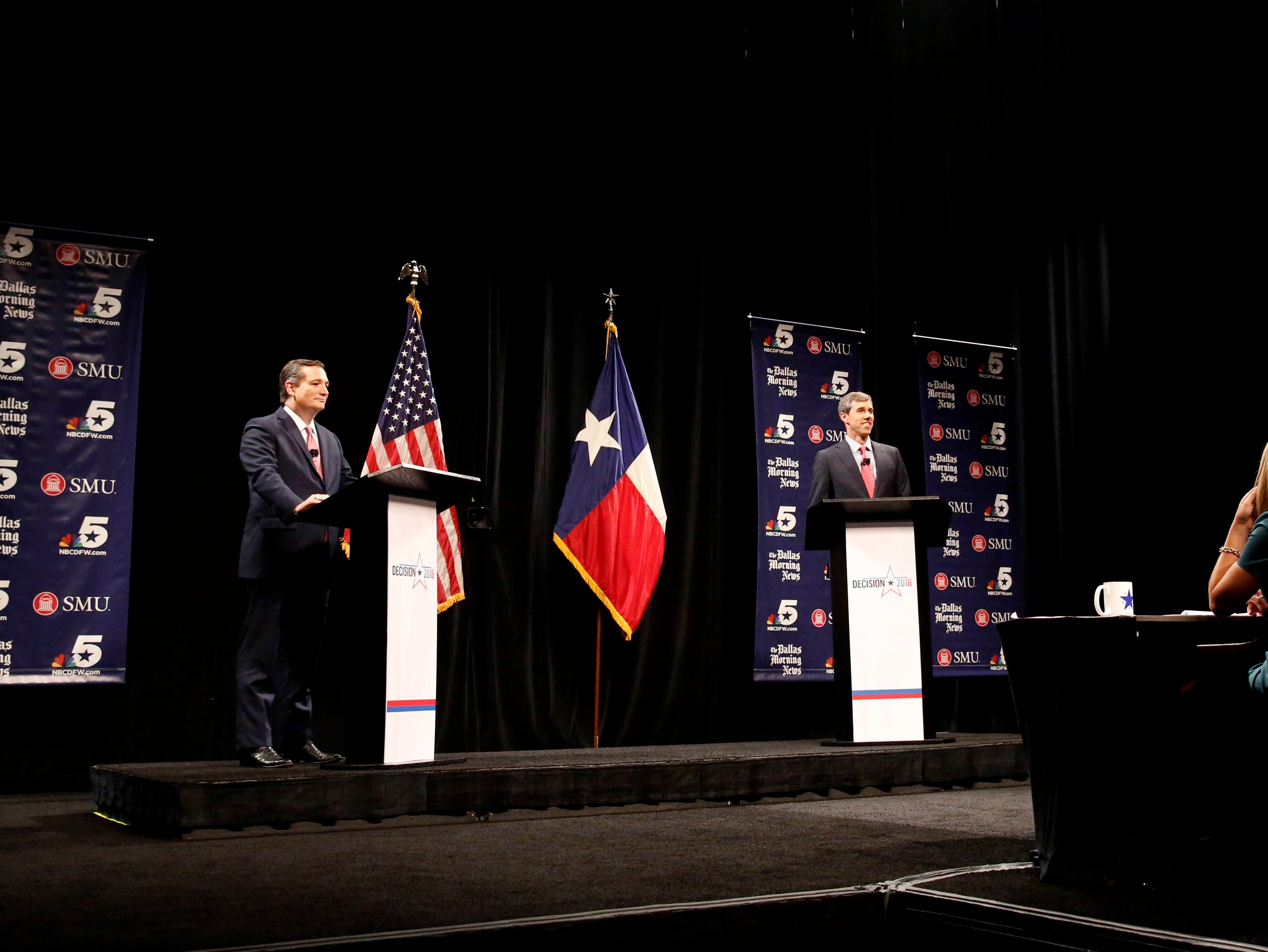 Republican U.S. Senator Ted Cruz, left, and Democratic U.S. Representative Beto O'Rourke, second from left, take part in their first debate for the Texas U.S. Senate in Dallas, Friday, Sept. 21, 2018. (Tom Fox/The Dallas Morning News via AP, Pool)