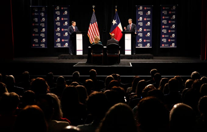 Republican U.S. Sen. Ted Cruz, left, and Democratic U.S. Rep. Beto O'Rourke take part in their first debate for a Texas U.S. Senate seat in Dallas on Sept. 21, 2018.