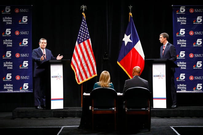 Republican U.S. Senator Ted Cruz, left, and Democratic U.S. Representative Beto O'Rourke, right, take part in their first debate for the Texas U.S. Senate in Dallas, Sept. 21, 2018. (Tom Fox /The Dallas Morning News via AP, Pool)