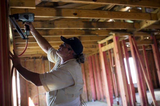 Mike Bellipanni works on his house and helps Habitat for Humanity volunteers on Friday, Sep. 21, 2018, in Corpus Christi. Baellipanni is attempting to raise $3,000 to cover the closing cost for his Habitat for Humanity house.