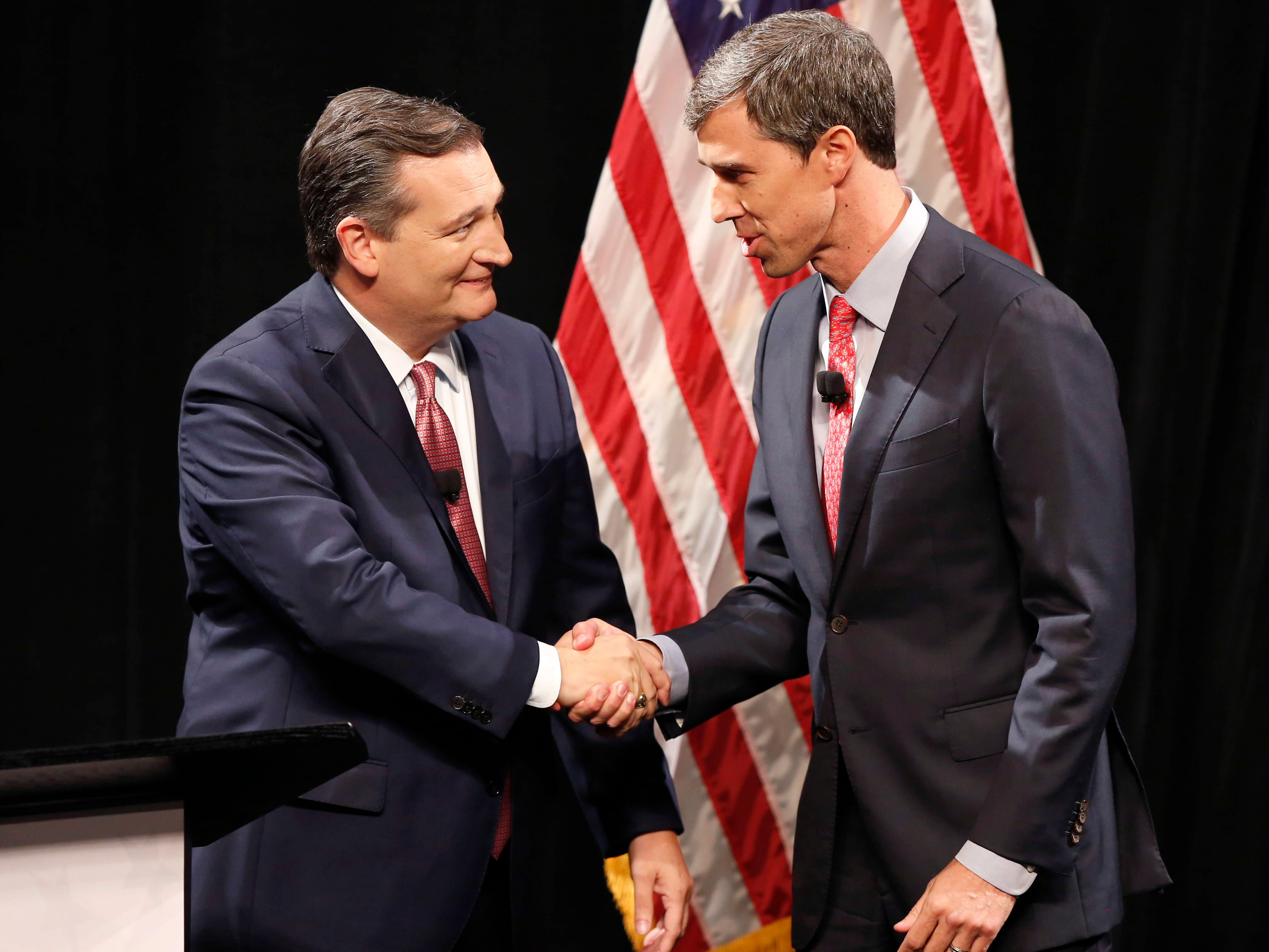 Republican U.S. Sen. Ted Cruz, left, and Democratic U.S. Rep. Beto O'Rourke shake hands before their first debate for a Texas U.S. Senate seat Sept. 21, 2018, in Dallas.
