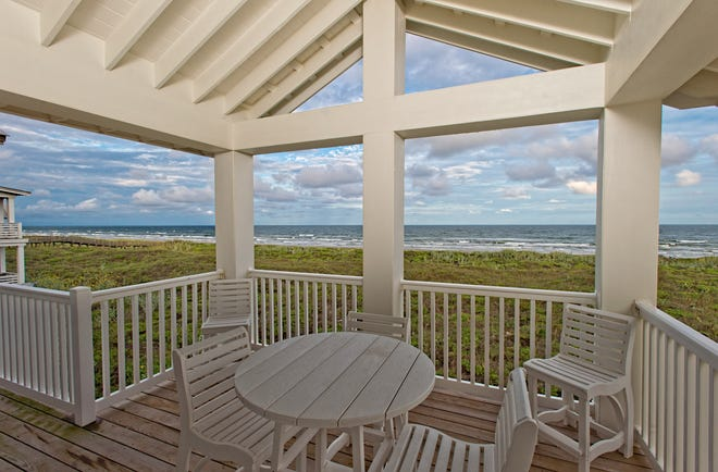 The third floor covered patio deck  features a cathedral beamed ceiling and panoramic views of the beach and Gulf of Mexico