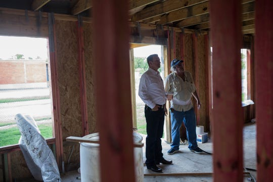 Jeremy Phillips (left), owner of Phillips Roofing and Restoration, and Mike Bellipanni talk about the ongoing construction on his house on Friday, Sep. 21, 2018, in Corpus Christi.