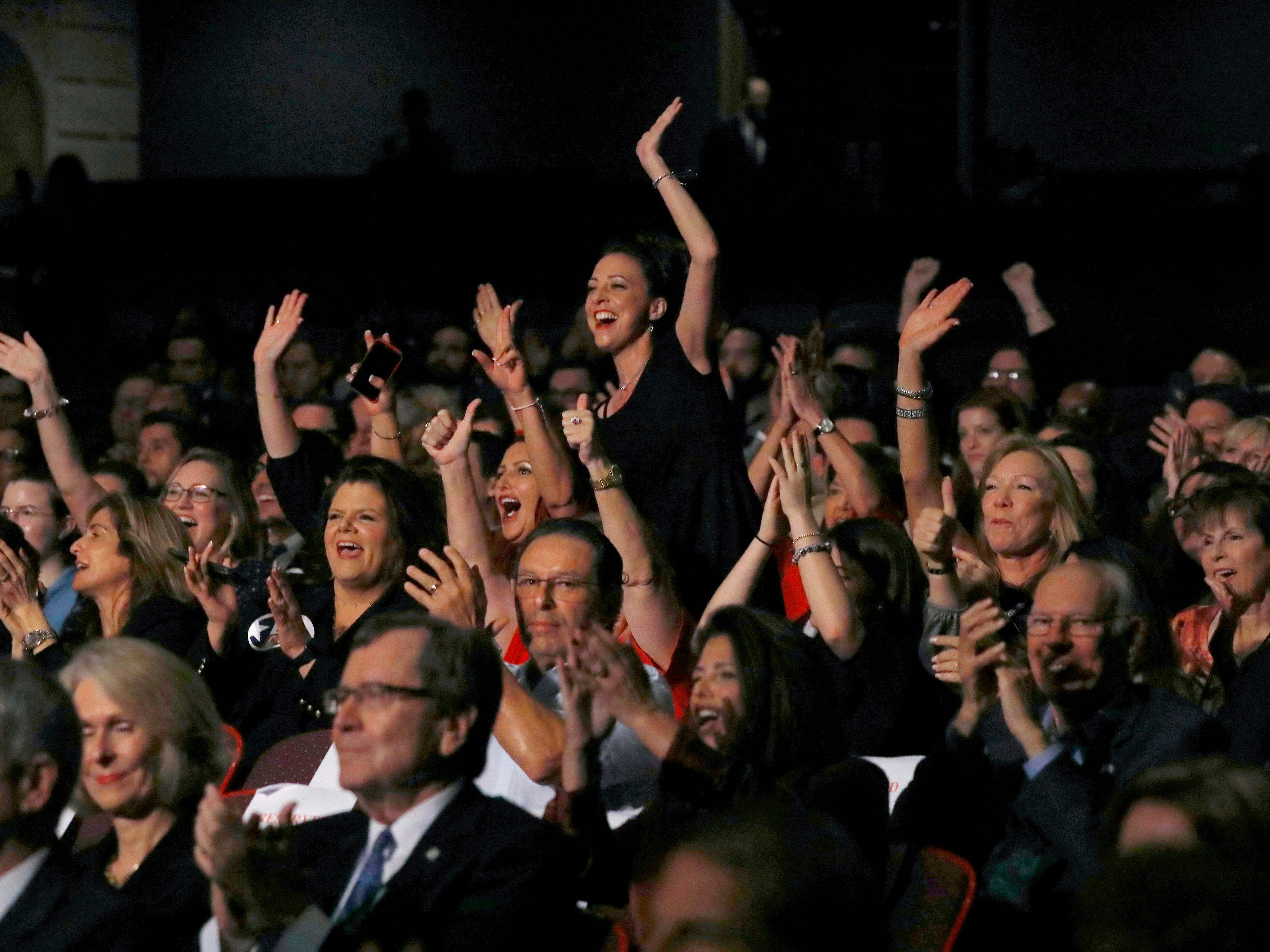 Members of the audience cheer as Republican U.S. Senator Ted Cruz and Democratic U.S. Representative Beto O'Rourke prepare to take part in their first debate for the Texas U.S. Senate in Dallas, Friday, Sept. 21, 2018. (Tom Fox/The Dallas Morning News via AP, Pool)