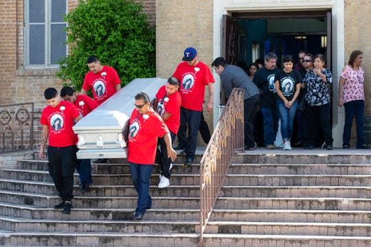 The casket for Nikki Enriquez is carried down the steps at Holy Redeemer Catholic Church in Laredo, Texas, after her funeral service on Friday, Sept. 21, 2018.